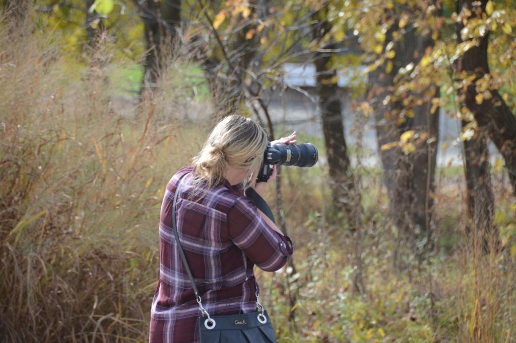 Girl taking photos. Nikon D600 photo taken on November 1, 2015 by Dave O at The Virginia B. Fairbanks Art & Nature Park in Indianapolis, Indiana.